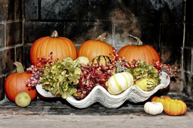 large shell with pumpkins and hydrangeas
