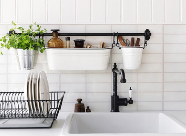 make the most of a tiny counter with a wall-mounted sink caddy