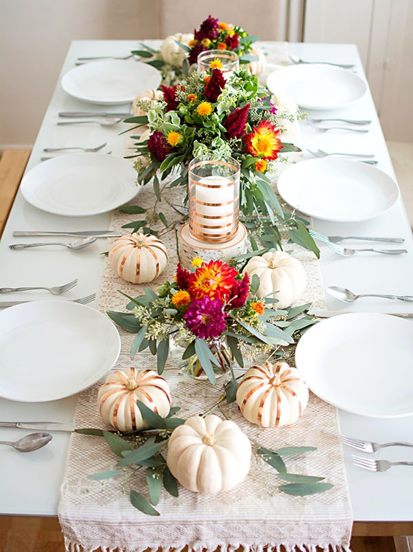 minimalist tablescape with a greenery and fresh pumpkins table runner
