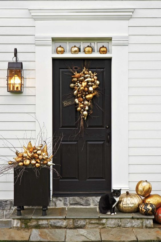 elegant gold door decor with gilded faux fruit and pumpkins