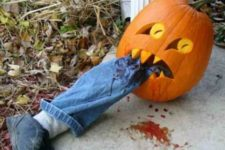 24 Halloween pumpkin eating a faux leg is a cool idea