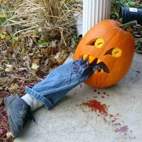 Halloween pumpkin eating a faux leg is a cool idea
