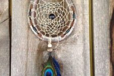 24 horseshoe shapeed dreamcatcher with a peacock and blue feather