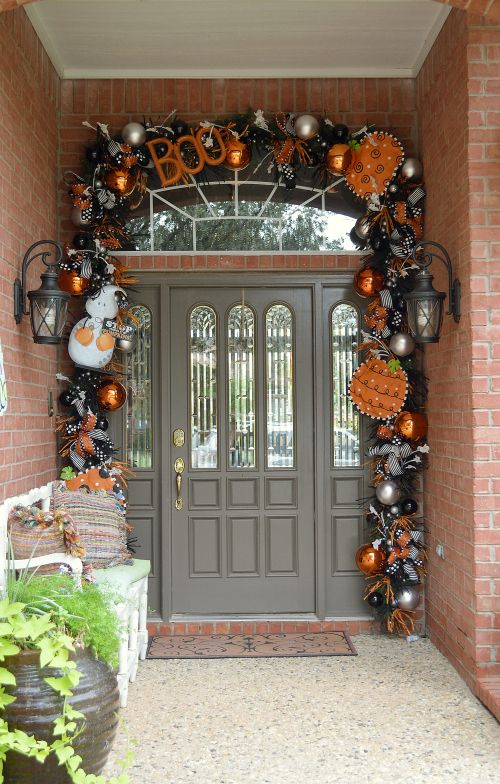 Halloween arch in black and orange with Christmas ornaments and deco mesh