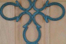 25 patina horseshoe cross instead of a door wreath