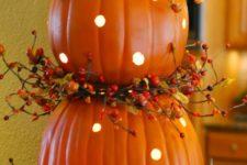 25 polka dot pumpkins with LEDs inside