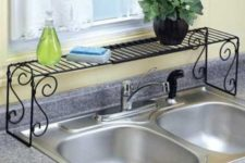 25 put a shelf over the sink to save some countertop space