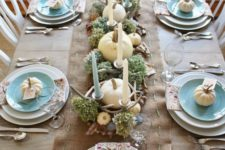 26 coastal table setting with white pumpkins, candles and sea stars