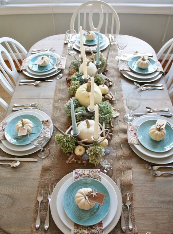 coastal table setting with white pumpkins, candles and sea stars