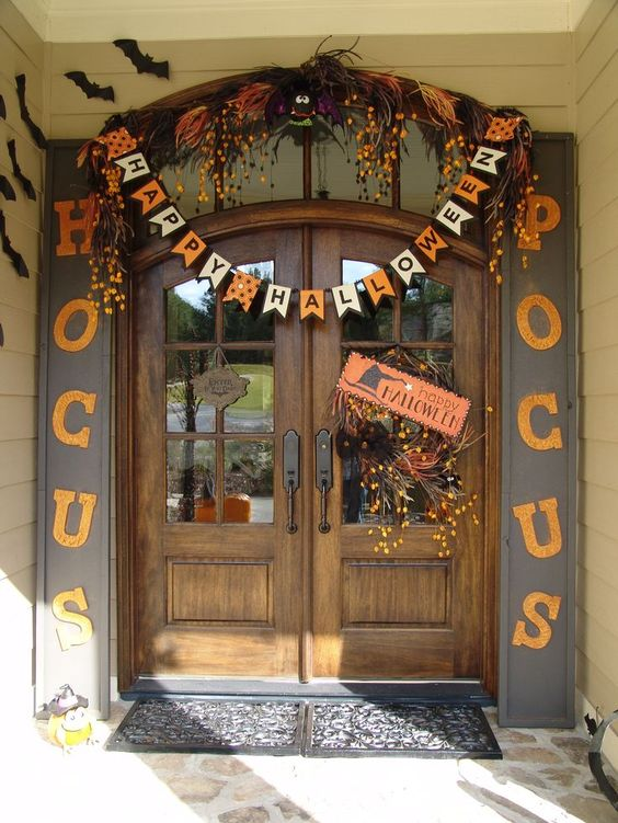 not spooky Halloween door decor in orange and black