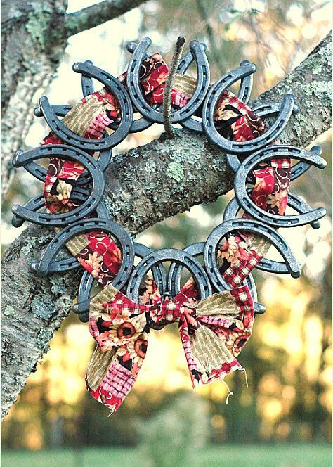 plastic horseshoes spray painted metal with plaid ribbon turned into a wreath