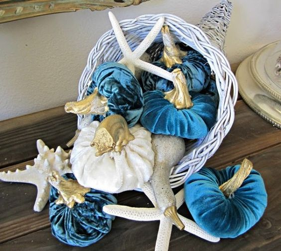 whitewashed cornucopia with star fish and velvet pumpkins