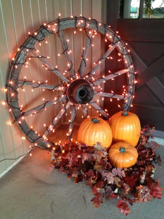 rustic-style decor with a large wooden wheel covered with lights