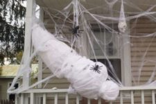 27 scary life-size spider victim on a porch