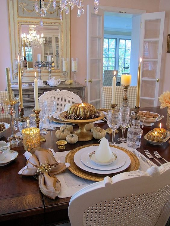 vintage gold and white table with pumpkins, candles and neutral placemats