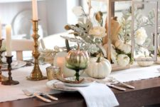 28 vintage-inspired table setting with candles and a pumpkin lantern