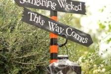 29 wicked decor with spiderweb, a raven and a lantern