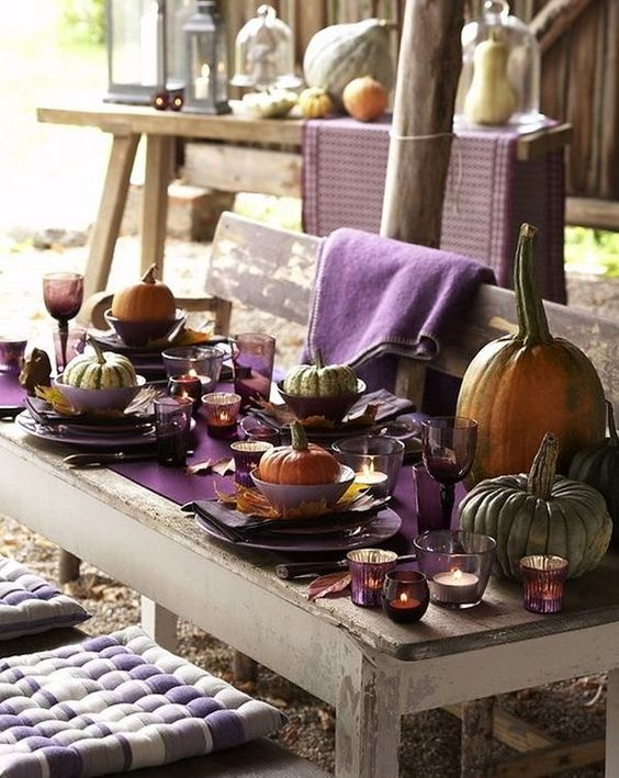 Bold Purple Table Setting With Pumpkins And Leaves