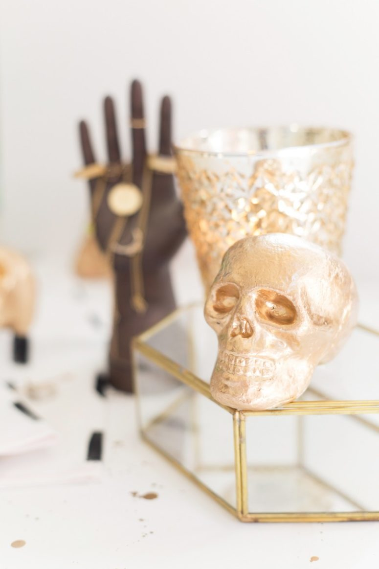 DIY gilded styrofoam skulls (via lovelyindeed.com)
