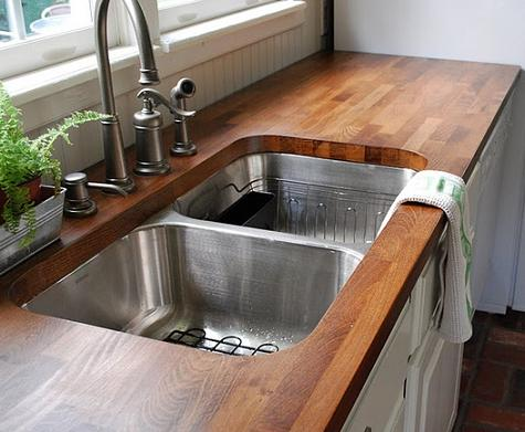 DIY butcher block kitchen sink countertop (via diycozyhome.com)
