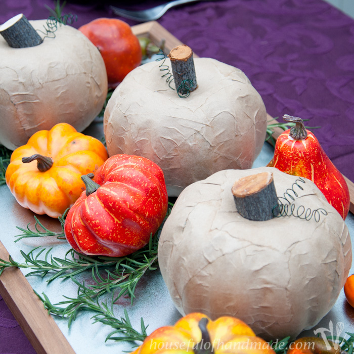 DIY dollar store pumpkins decorated in a creative way