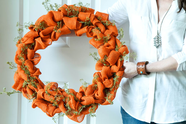 DIY bold orange burlap wreath with faux greenery (via inspiration.kenmore.com)