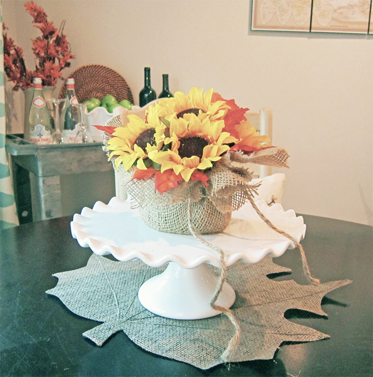 DIY fall centerpiece with burlap and faux flowers and leaves (via thehoneycombhome.com)