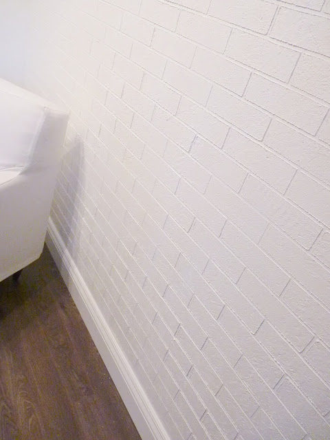 DIY exposed brick wall using interior stucco