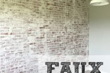 DIY faux brick walls using paneling and white paint