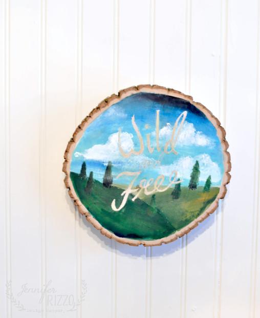 DIY wood slice artwork with acrylic paints