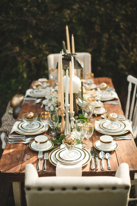 elegant table decor with gilded faux pumpkins, lanterns and candles