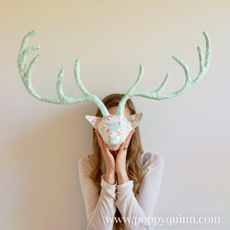 DIY paper mache deer head covered with pastel fabric (via www.poppyquinn.com)