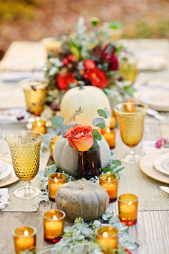 fresh flowers and eucalyptus with a lot of votives bring a festive touch