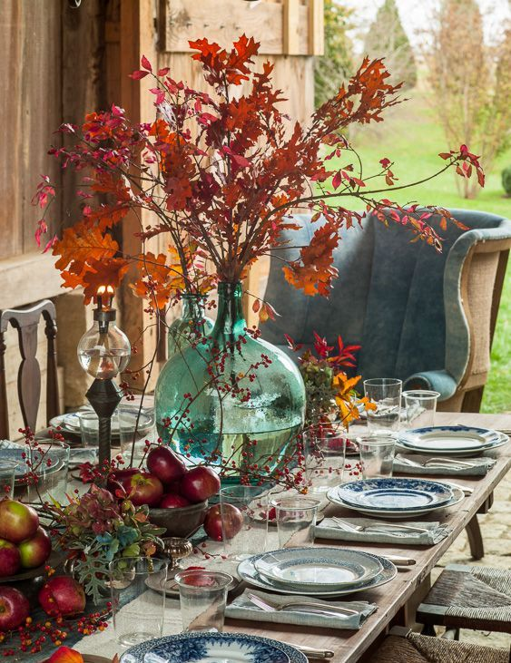 harvest-inspired tablescape with fall leaves and fruit and chinoiserie