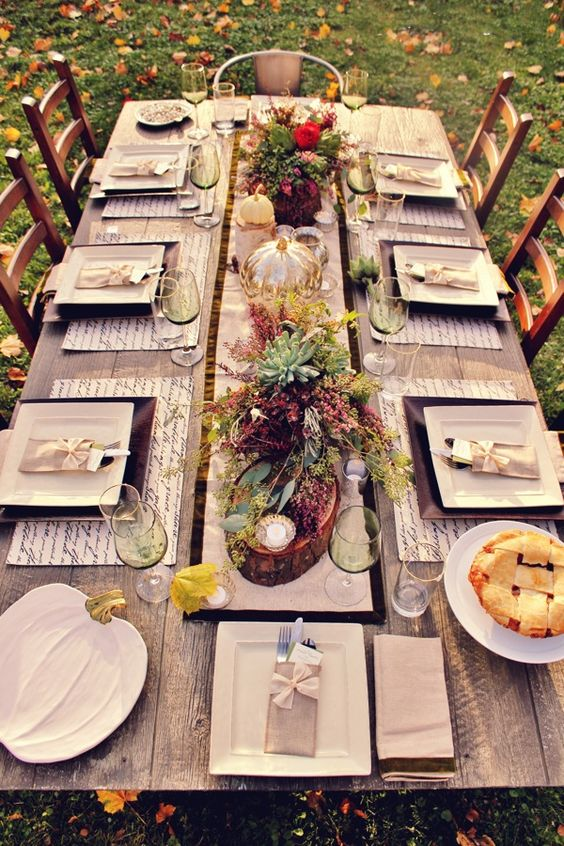 modern table decor with flowers and succulents, handwriting placemats and votives