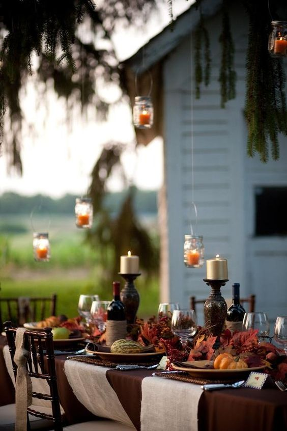 moody vintage table setting in burgundy, brown and orange colors