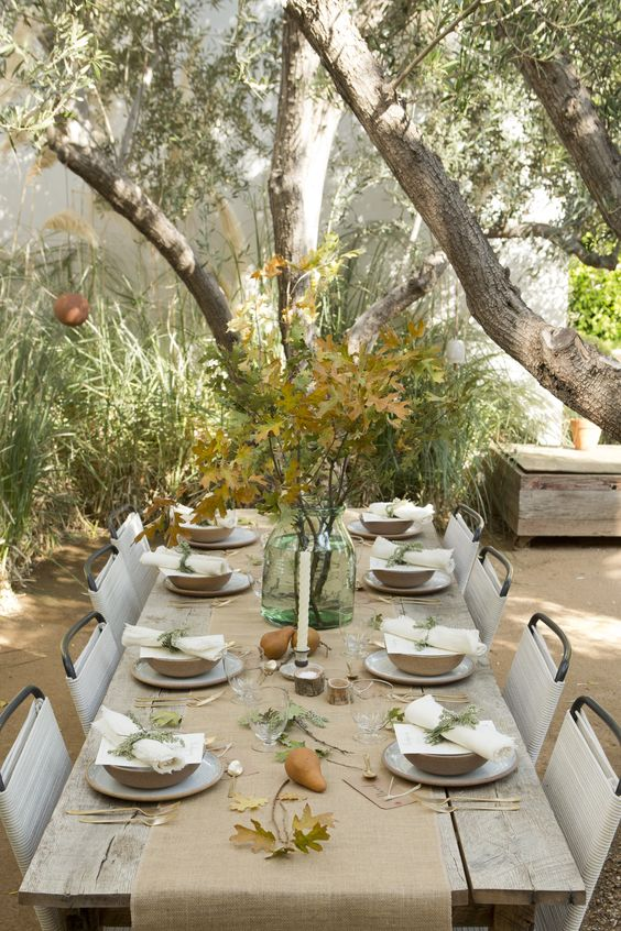 neutral and natural tablescape with pears, leaves and a burlap table runner