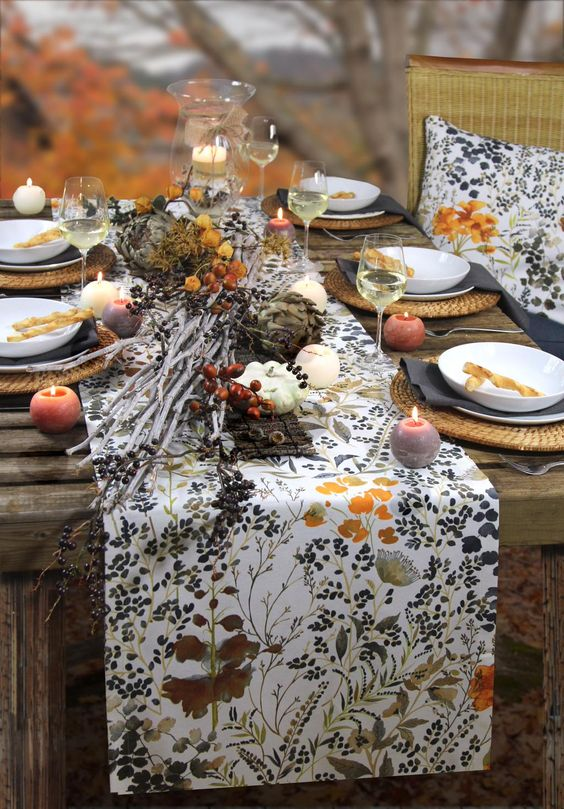 printed table runner, colorful candles and woven chargers for a nature-inspired table