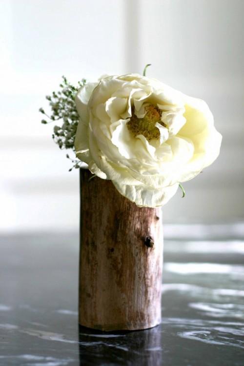 DIY flower vase of a wood log (via www.shelterness.com)