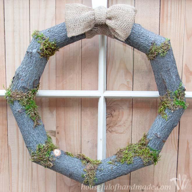 DIY fall wreath made of logs and moss (via housefulofhandmade.com)