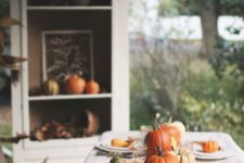 traditional table decor with corn, pumpkins and gourds