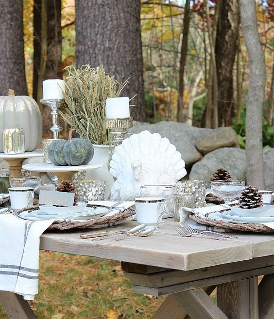 traditional table style with wheat, faux pumpkins, pinecones and a turkey