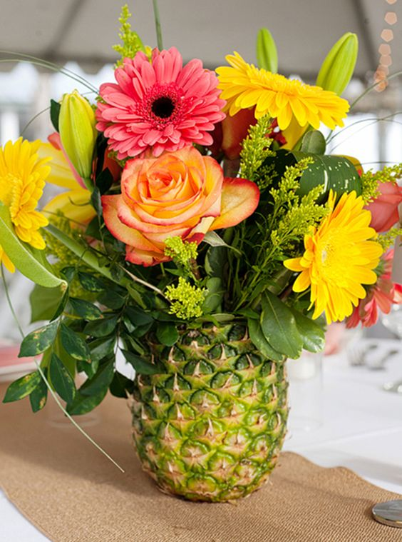 Luau Party Decor A Pineapple Can Be Used Instead Of Vase To Make Bold Flower Centerpiece