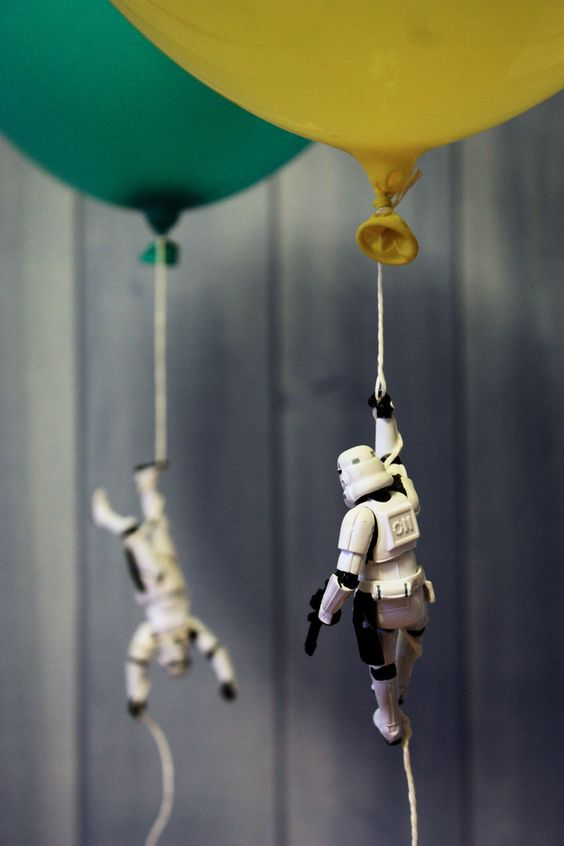 attach plastic stormtroopers to the balloon strings