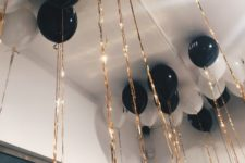 03 black and white balloons with golden tassels