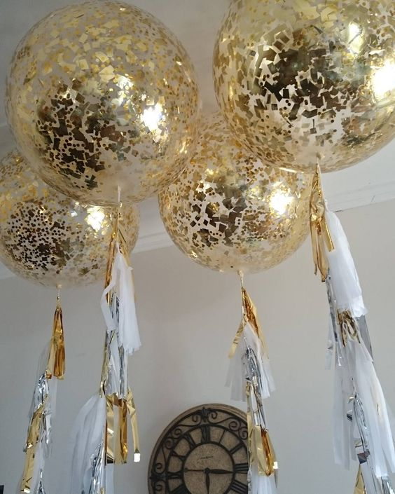 giant gold confetti inside ballons and metallic tassels