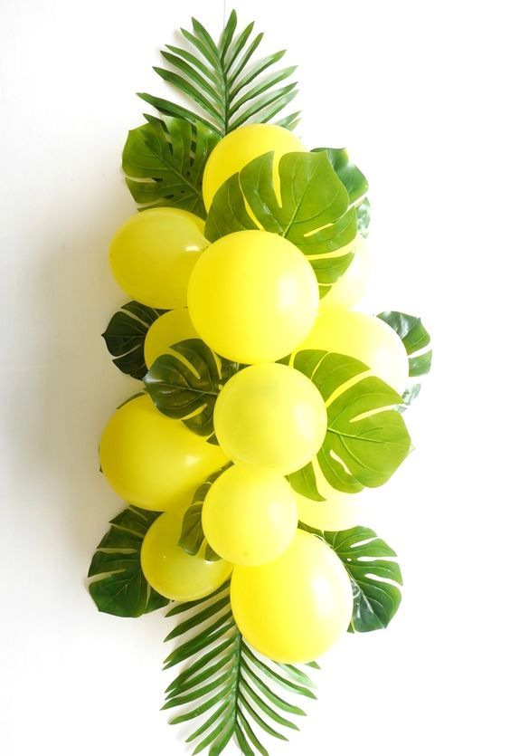 balloons and fronds tropical centerpiece
