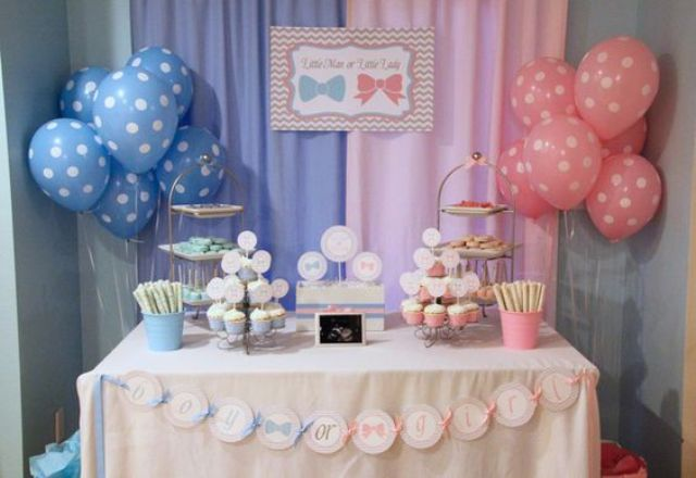 dessert table with balloons of pink and blue colors