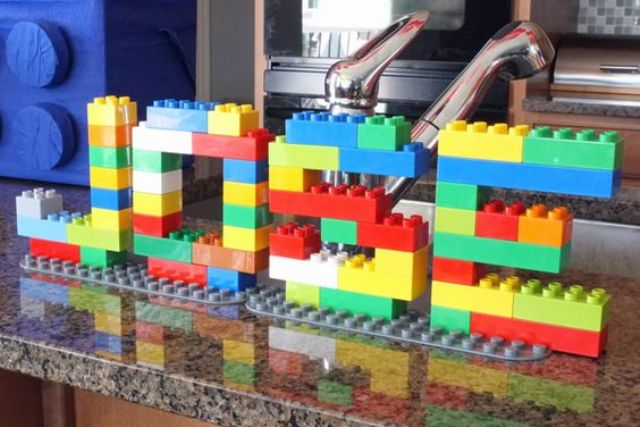 easy party decor with big legos spelling out birthday kids name
