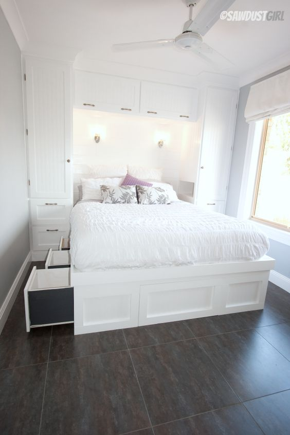 built in wardrobes and a platform bed with drawers